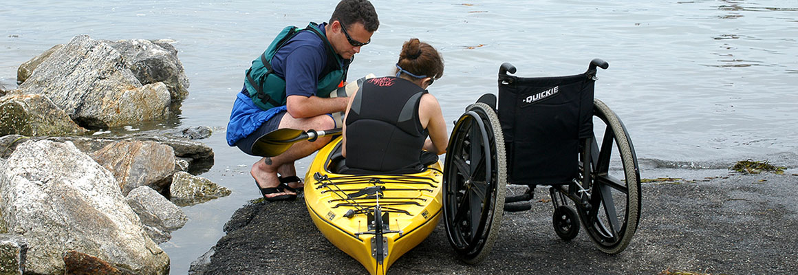 Getting ready to launch the kayak with passenger with a physical disability