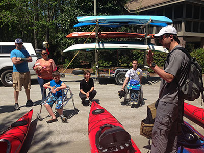 Adaptive Paddling Workshop group debriefing adaptive outfitting