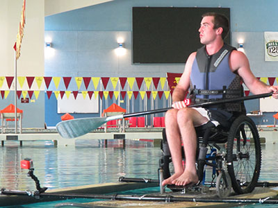 Wheelchair paddleboarding in the pool