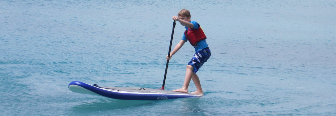 Youth stand up paddleboarding