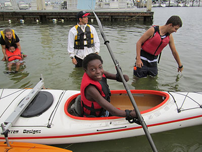 Young girl showing off adaptive paddling skills