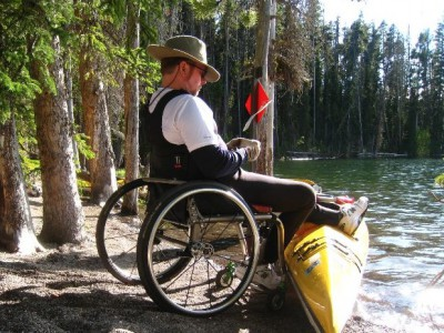 Wheelchair kayaker in the wild