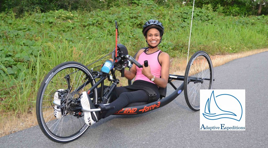 Photo of woman on a handcycle.