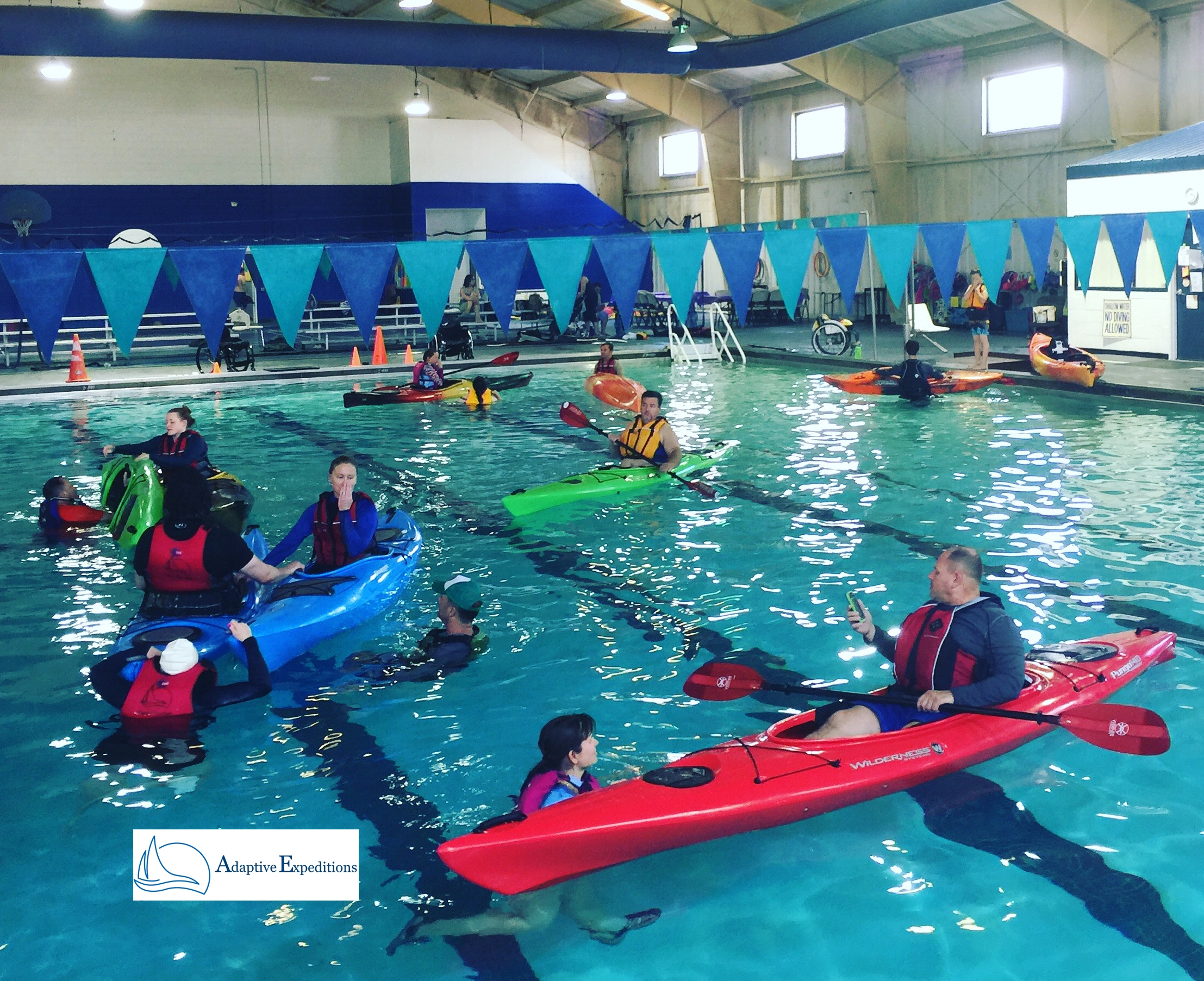 Photo of adaptive paddle sport kayak pool session.